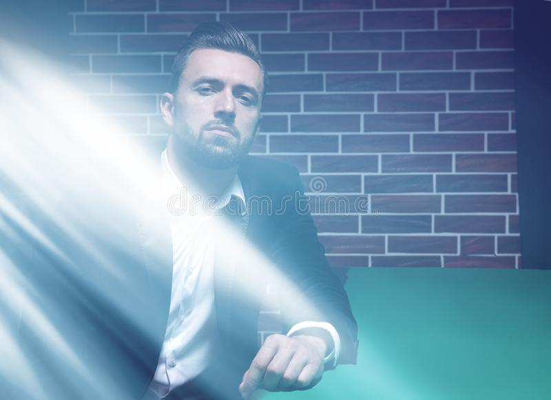 Poker player with suit royalty free stock image