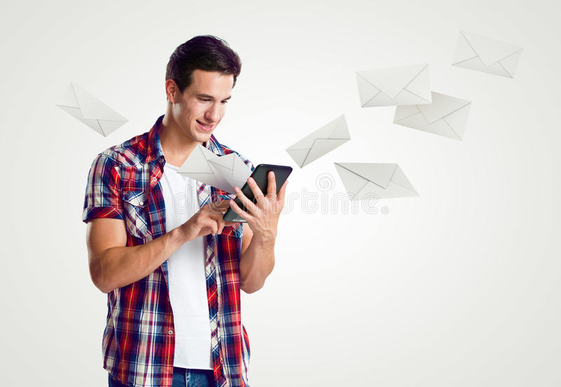 Young man receive mail over tablet. Concept royalty free stock photos