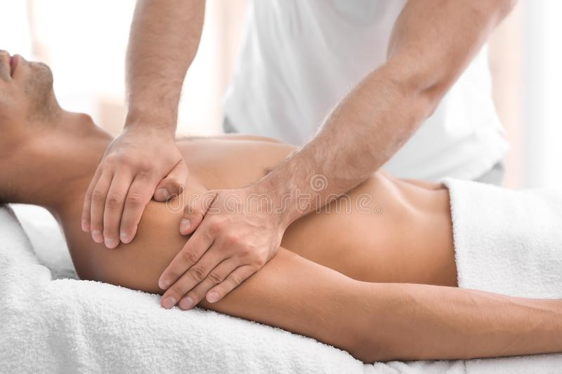 Young man receiving massage in salo. N, closeup royalty free stock image
