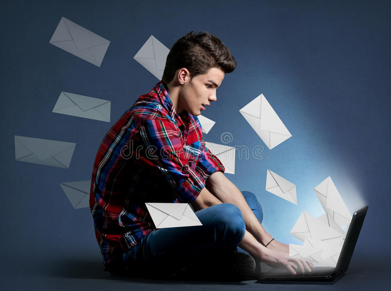 Young man receiving tons of messages on laptop. Communication concept