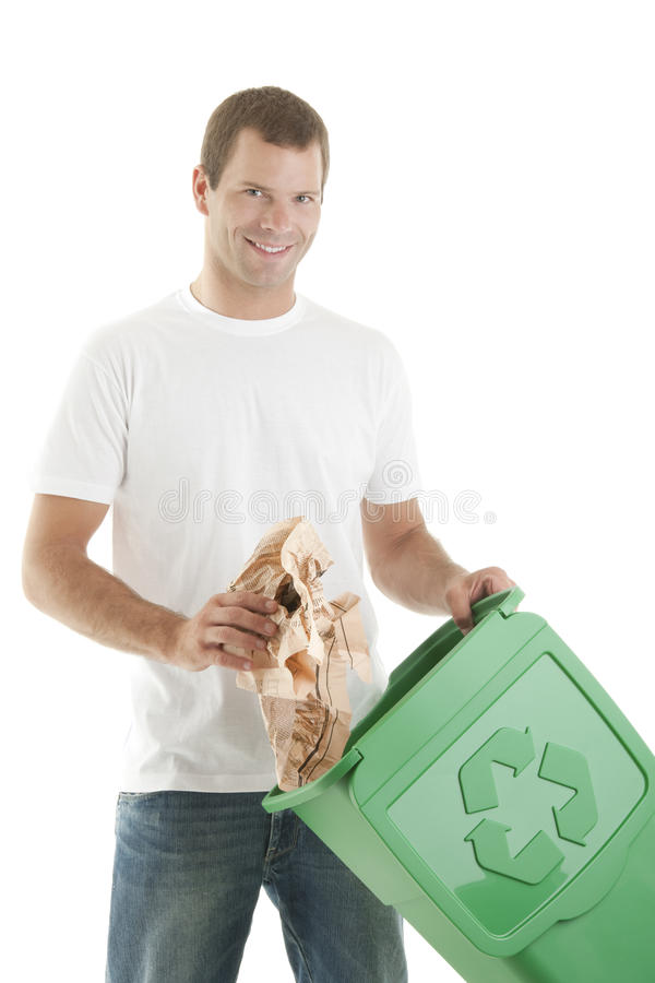 Young man recycling paper stock photography