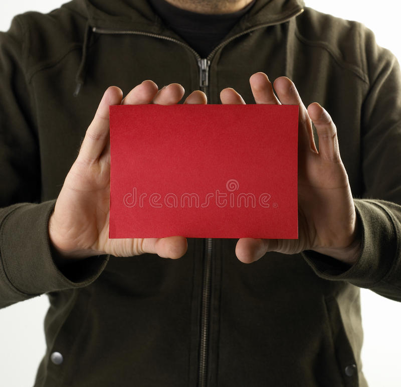 Young man with an red empty card royalty free stock images