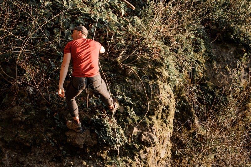 Young man dulfers down the mountains in Adjara. Young man in red shirt and cap dufers down the mountains in Adjara royalty free stock photos