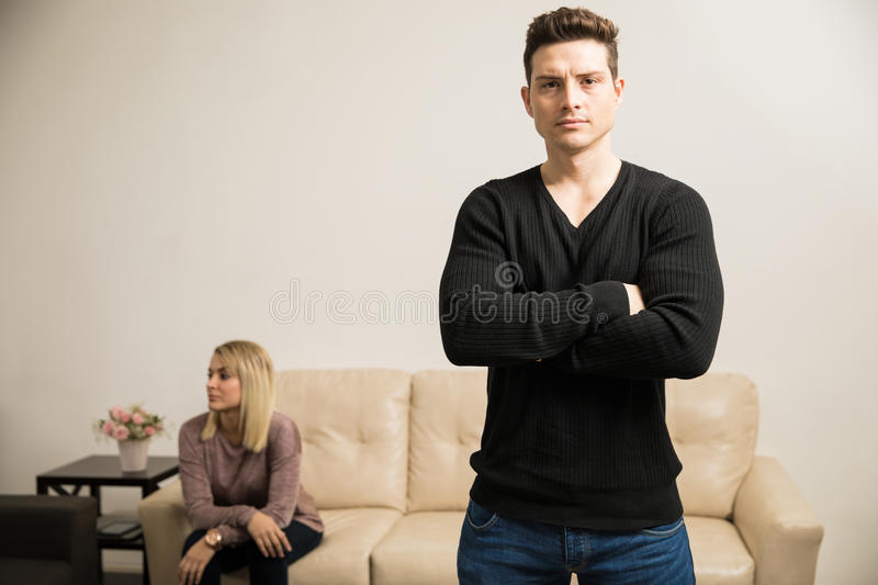 Young man with relationship problems. Handsome young Hispanic men with his arms crossed looking upset due to relationship problems royalty free stock photography