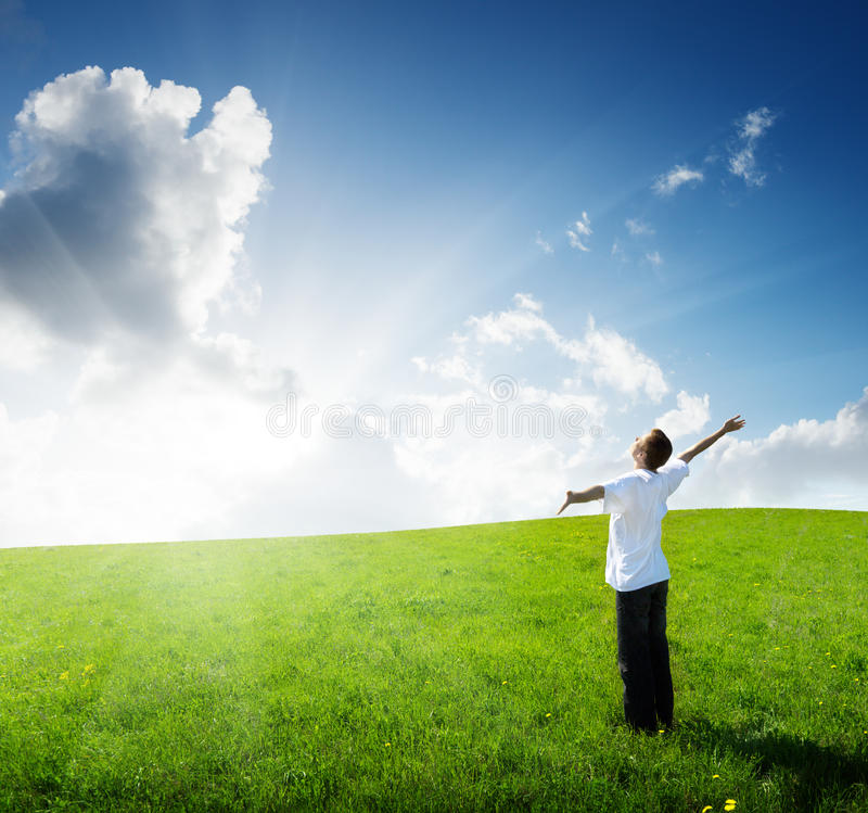 Young man relax on the field. Young man relax on the green field royalty free stock photography