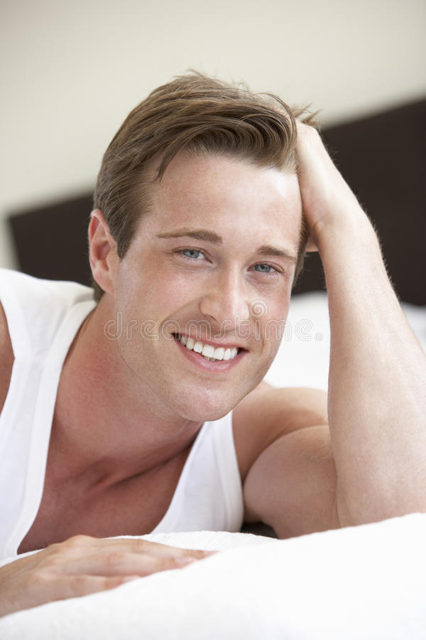 Young Man Relaxing On Bed stock images