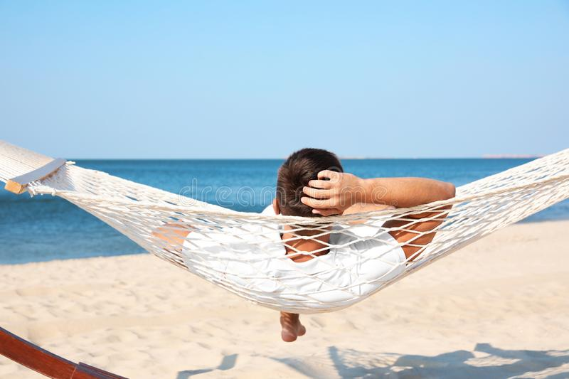 Young man relaxing in hammock royalty free stock image