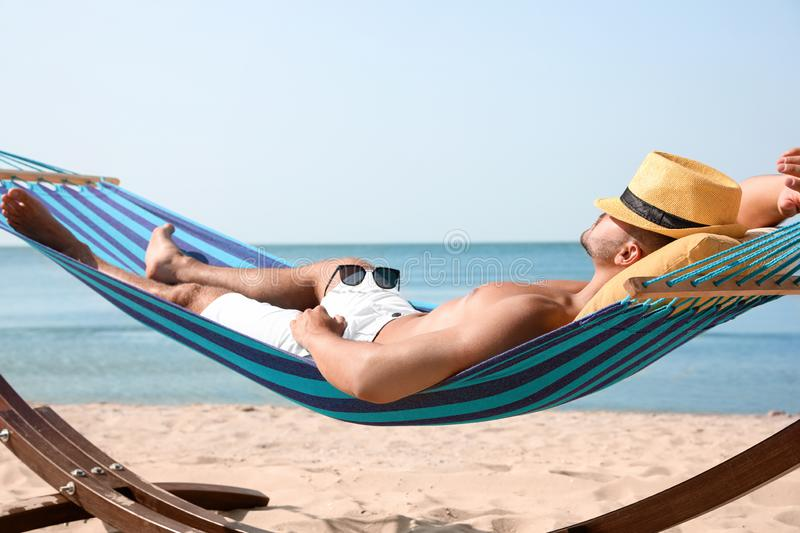Young man relaxing in hammock royalty free stock photography