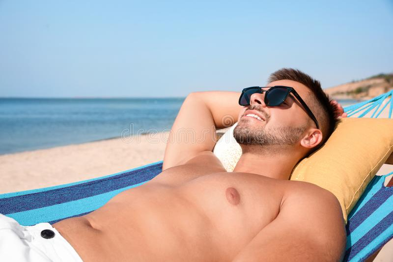 Young man relaxing in hammock stock photography