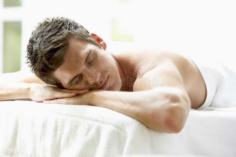 Download Young Man Relaxing On Massage Table Stock Photo - Image: 9388446