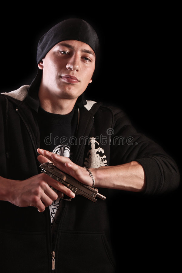 Young man reload a gun on black royalty free stock image