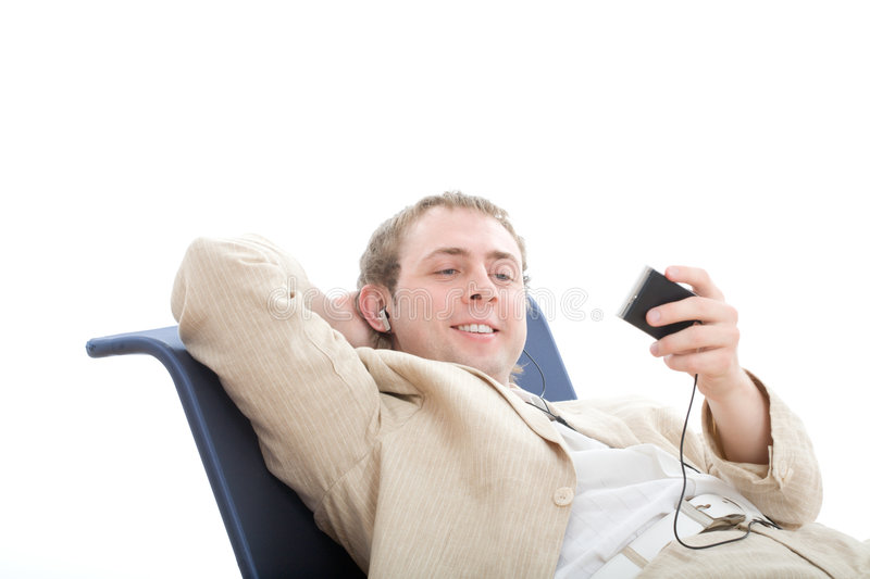 Download Young Man Rest In Chair And Listens Digital Player Stock Image - Image: 5097521