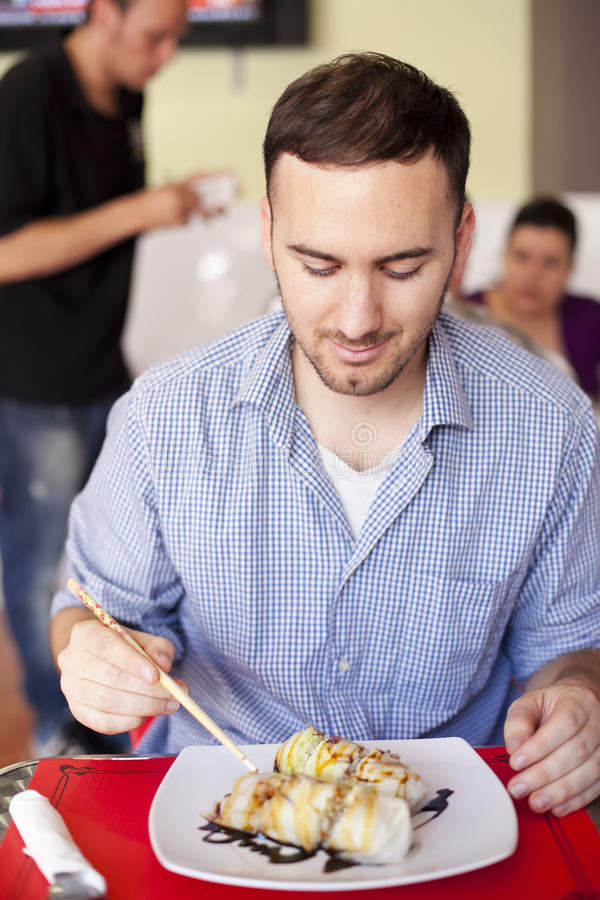 Young man in restaurant stock photos