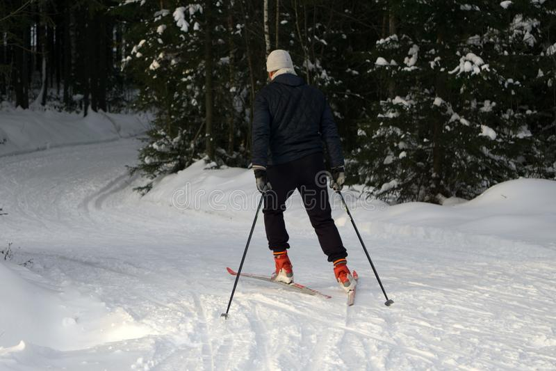 A young man rides cross-country skiing. Active winter. Active guests. Amateur sports. stock images
