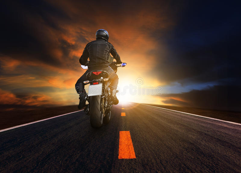 Young man riding big motorcycle on asphalt highway use for people leisure and motorsport activities royalty free stock images