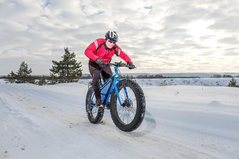 Fat bike. Fat tire bike. A young man riding fat bicycle in the winter. A young man riding fat bicycle in the winter. winter biking. Fatbike. Fat tire bike stock image