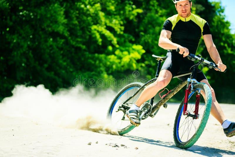 Young Man Riding His Mountain Bike stock image