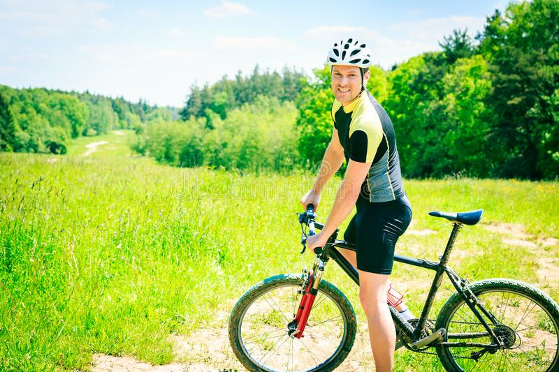 Young Man Riding His Mountain Bike royalty free stock images