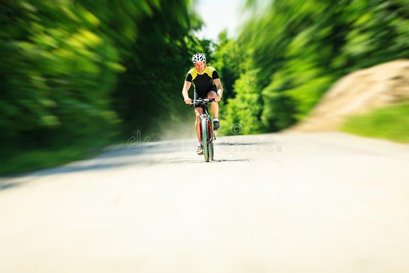 Young Man Riding His Mountain Bike stock photos