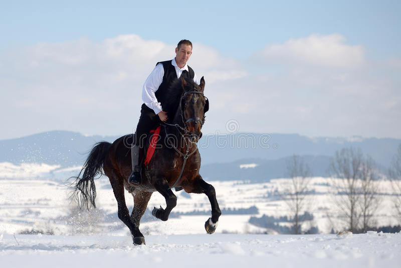 Download Young Man Riding Horse Outdoor Stock Photo - Image: 40071586