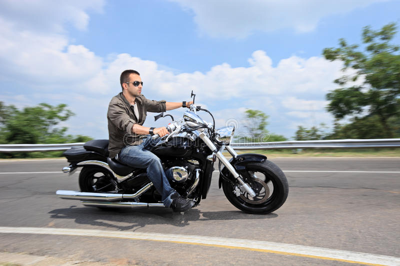 Download Young Man Riding A Motorcycle On An Open Road Stock Image - Image of motorbike, move: 19779883