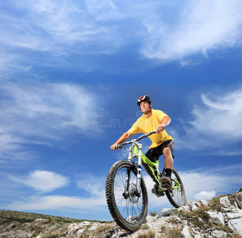 Young man riding a mountain bike outdoor royalty free stock photos
