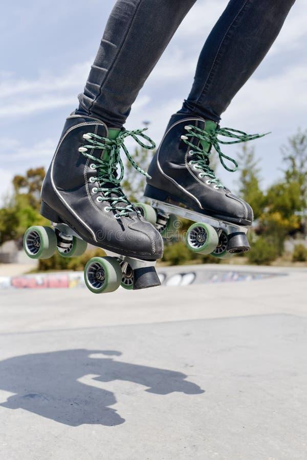Young man roller skating stock image