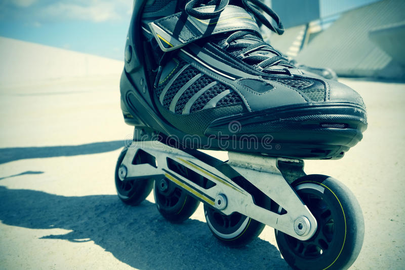 Young man roller skating, filtered stock images