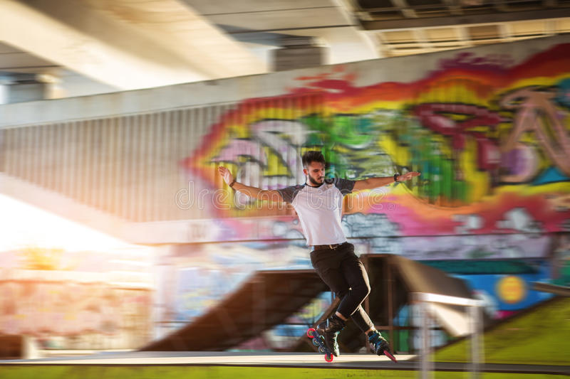 Young man is rollerblading. royalty free stock images