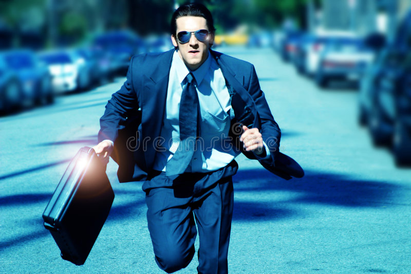 Young man running stock photo