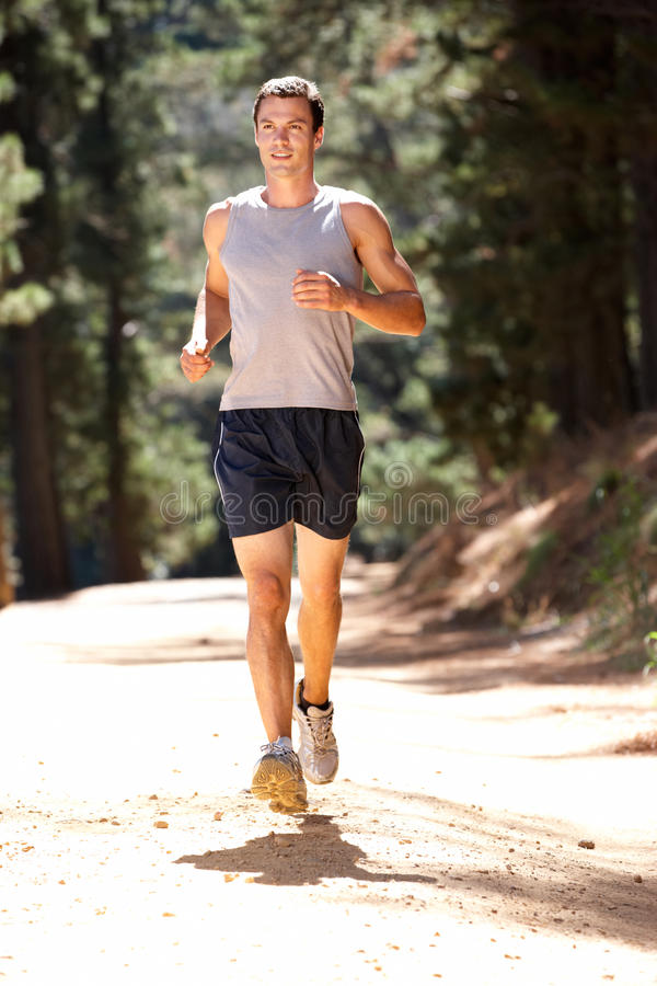 Young Man Running Along Country Lane Stock Image