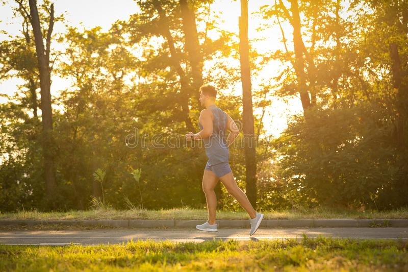 Young man running on sunny day royalty free stock image