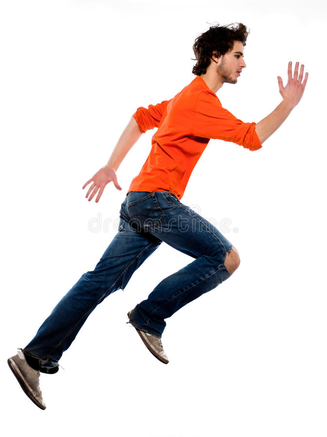 Young man running profile full length. One caucasian young man running profile full length in studio on white background royalty free stock photography