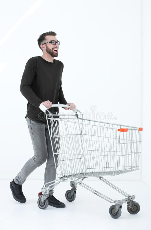 Successful young man with a shopping cart stock photos