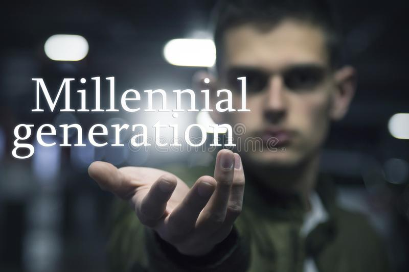 Millennial generation message. Young man`s hand with millennial generation message royalty free stock photography