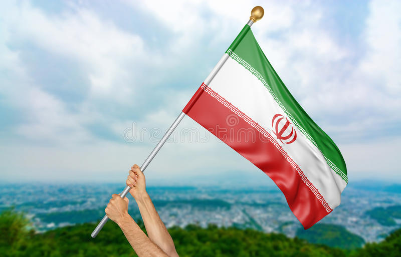 Young man`s hands proudly waving the Iran national flag in the sky, part 3D rendering royalty free illustration