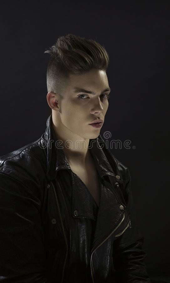 Young man`s portrait. Stylish handsome Guy in black leather fashionable rocker-style jacket, Close-up royalty free stock images