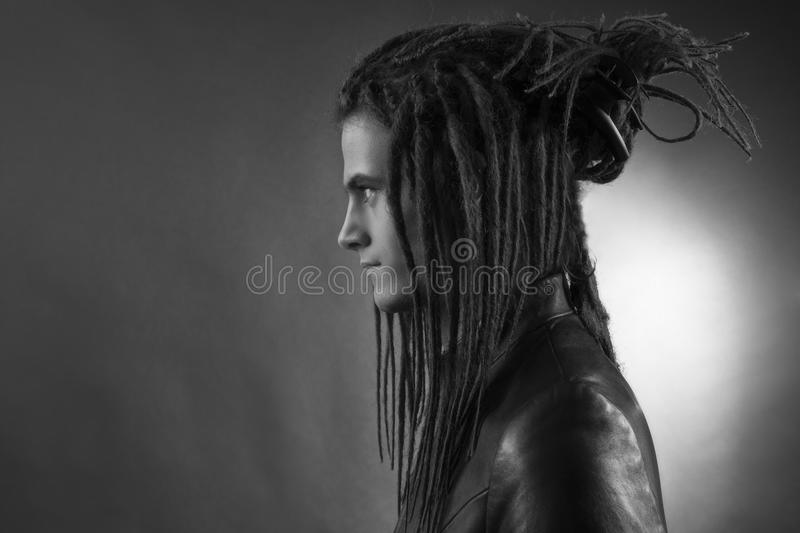 Young man's portrait. Stylish handsome Guy with Dreadlocks royalty free stock photo