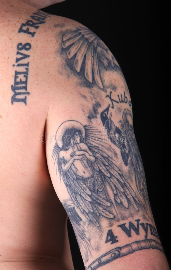 Young man's tattooed arm royalty free stock images
