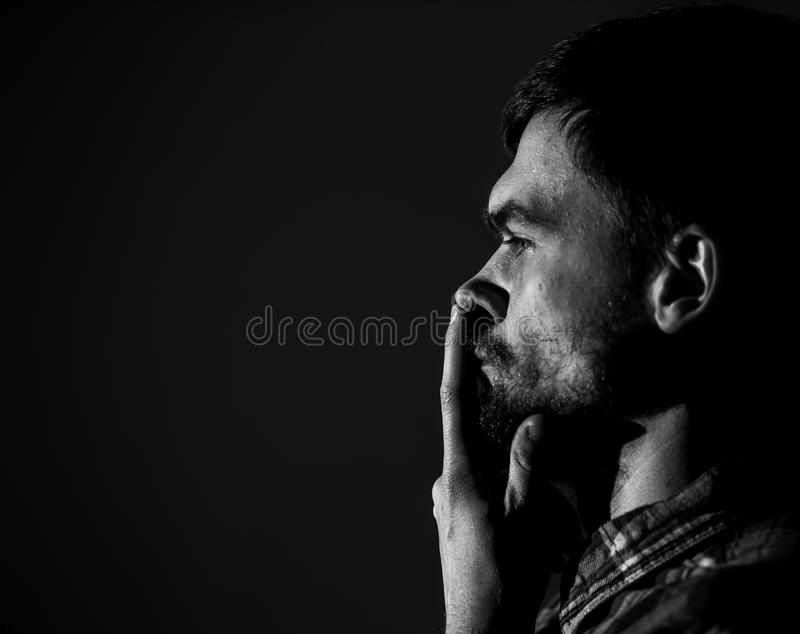 Young man, sad emotions, black and white photography royalty free stock image