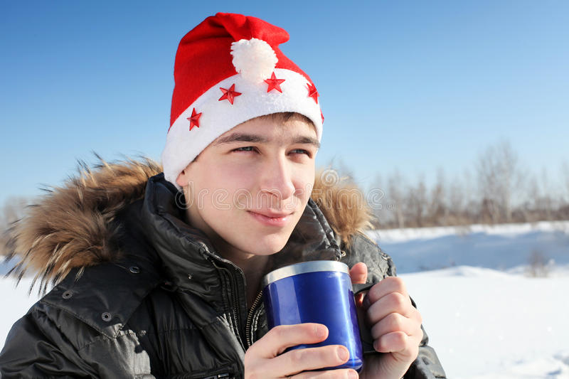 Download Young man in santa hat stock image. Image of stand, cold - 27070975