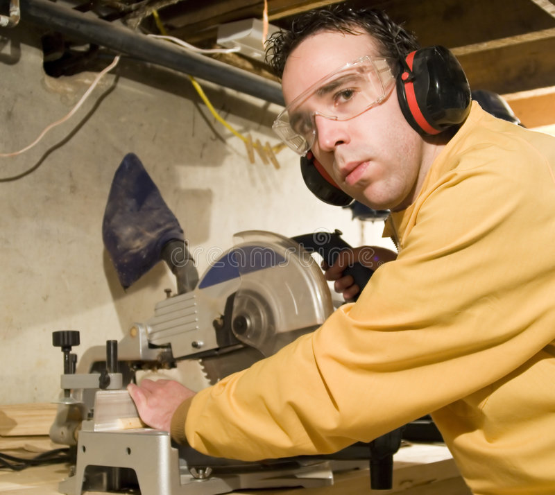 Download Young Man Sawing Some Wood stock photo. Image of laborer - 4162204