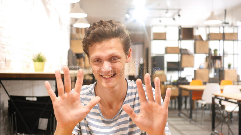 young man saying stop; denial gesture , rejecting , no stock photos