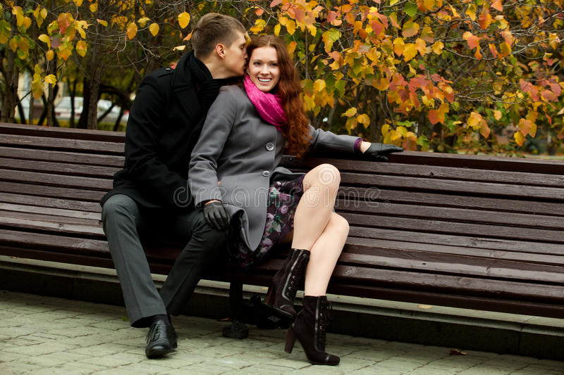 Download Young Man Says Something In Ear Of A Woman Stock Image - Image: 21824123