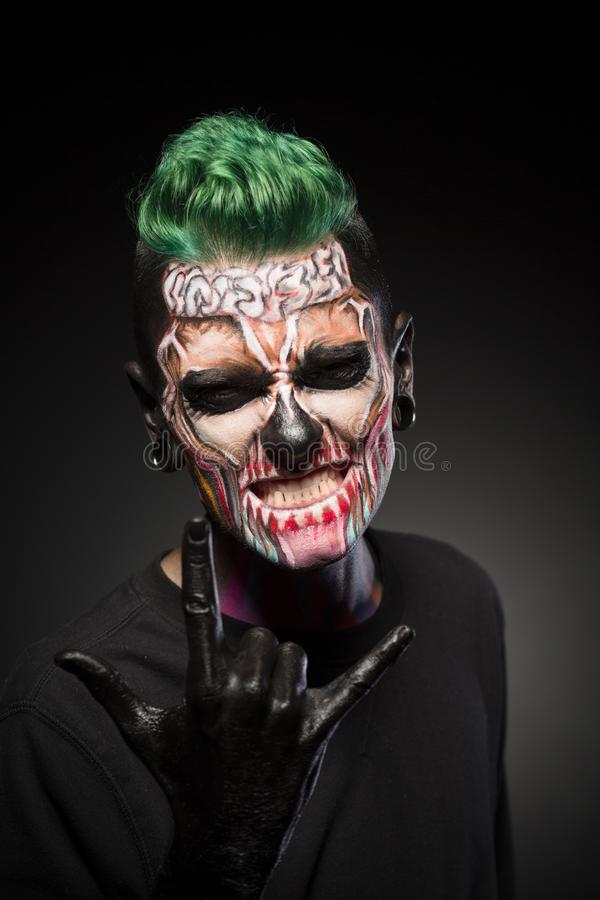 Young man with scary skeleton face. stock photo
