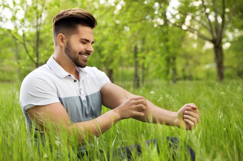 Young man scratching hand. Seasonal allergy royalty free stock images