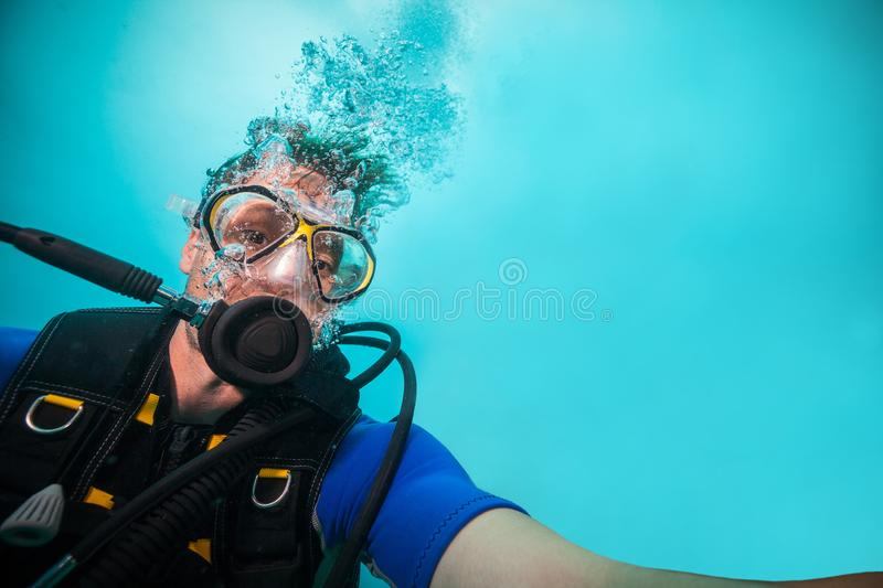 Young man scuba diver making selfie royalty free stock photo