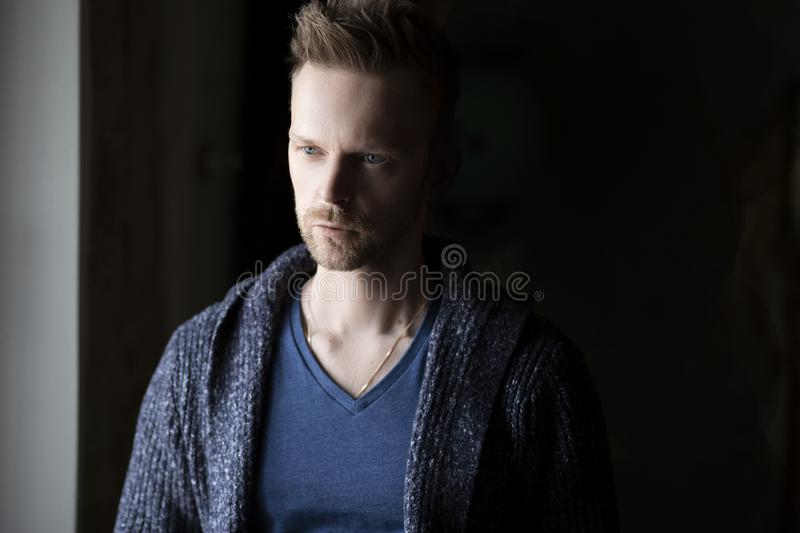Young man with serious look on his face stock images