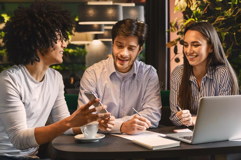 Young man sharing creative ideas with colleagues royalty free stock images