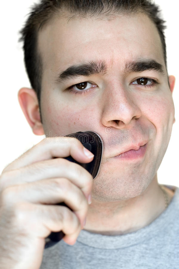 Download Young Man Shaving stock photo. Image of electric, holding - 10103220